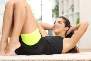 Fitness woman doing crunches on the floor